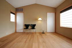 寝室は色味を落として落ち着きある空間に。